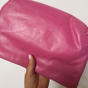 Pink crossbody clutch with removable strap